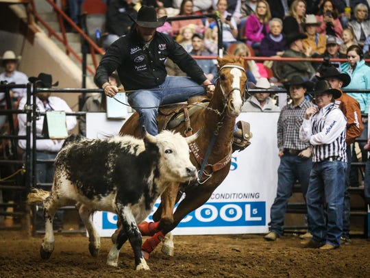 Jacob Talley rides out to steer wrestle during the 2018 San Angelo Stock Show & Rodeo.