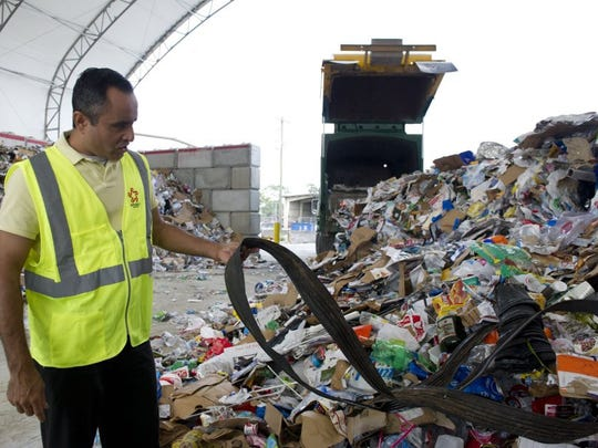 Himanshu Mehta, managing director of the Indian River County Solid Waste Disposal District, describes the types of materials accepted for recycling on Feb. 4 at the Indian River County Landfill. Paper can now be mixed with plastic and glass. (LEAH VOSS/TREASURE COAST NEWSPAPERS)      CQ: Himanshu Mehta   TAKEN: Thursday, February 4, 2016