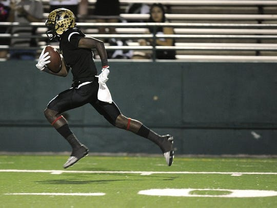 Thomas Metthe/Reporter-News Abilene High wide receiver Raekwon Millsap (1) runs the ball for a 56-yard touchdown reception during the first quarter of the Eagles' 59-21 win on Thursday, Oct. 27, 2016, at Shotwell Stadium.