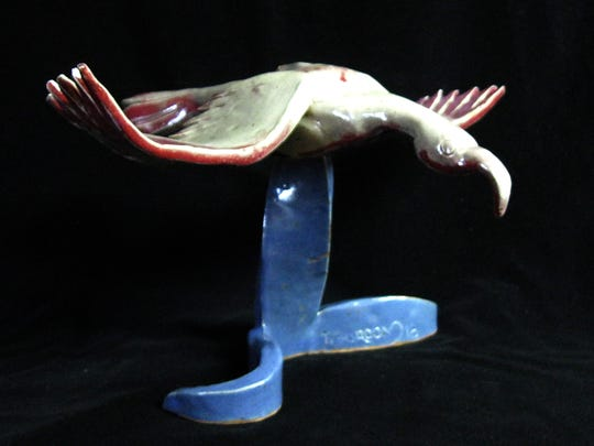 """In Flight,"" a sculpture by Timithy Gordon, will be displayed at the Chile Pod during the June art walk this weekend in downtown Farmington."