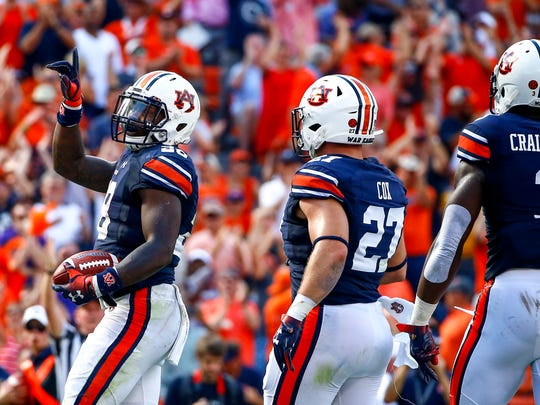 Auburn running back JaTarvious Whitlow (28) celebrates after scoring a touchdown during the first half of an NCAA college football game against LSU, Saturday, Sept. 15, 2018, in Auburn, Ala. (AP Photo/Butch Dill)