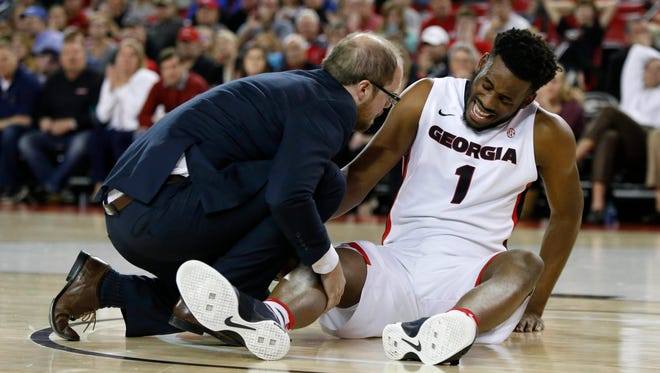 Georgia Bulldogs forward Yante Maten goes down with an injury against Kentucky.