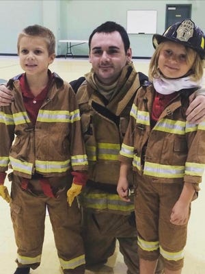 Lt. Christopher Taylor, middle, was injured in a motorcycle crash on Tuesday in Evansville. Taylor is a firefighter with both German Township and Toyota.
