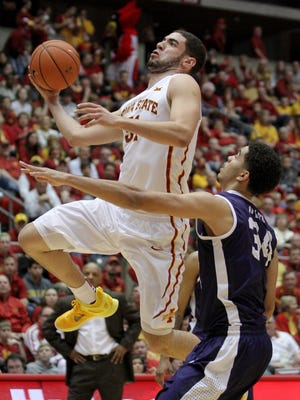 Iowa State forward Georges Niang drives past TCU forward Kenrich Williams during the first half of Saturday's game at Hilton Coliseum in Ames. The Cyclones won 83-66.
