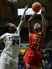 Maryland guard Shatori Walker-Kimbrough (32) shoots over Purdue guard Andreona Keys (24) during the first half of an NCAA college basketball game in West Lafayette, Ind., Tuesday, Feb. 2, 2016.