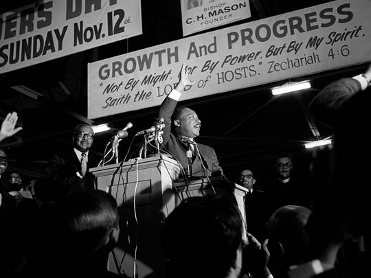 """Dr. Martin Luther King Jr., who was on a tour of the South to recruit volunteers for his """"Poor People's Campaign"""", spoke to an overflow crowd at Mason Temple March 18, 1968. Crowd estimates ranged from 9,000-13,000. Speaking in support of striking sanitation workers, King called for a general work stoppage by black Memphians if the city did not agree to a union dues checkoff. """"Along with wages and other securities, you're struggling for the right to organize. This is the way to gain power. Don't go back to work until all your demands are met"""", Dr. King told the crowd. He pledged to return to Memphis on March 22 to lead a march that was postponed because of a near record snowfall. The protest was rescheduled for March 28. The march ended in disorder with looting and vandalism along Beale and Main Streets. Police moved in with tear gas and nightsticks. By day's end, one person had been killed and more than 60 injured. King would agonize over what happened and vowed to return to lead a peaceful mass march. On Wednesday, April 3, King again returned to Memphis. That night, more than 2,000 listened as he gave his famous """"Mountaintop"""" speech at Mason Temple. The next day, at 6:01p.m., an assassin's bullet struck Dr. King as he stood on the balcony outside room 306 at the Lorraine Motel. (By Vernon Matthews / The Commercial Appeal)"""