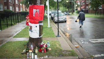 A makeshift memorial is shown along the sidewalk in the Lawndale neighborhood where a 22-year-old man was shot and killed over the Labor Day weekend on September 8, 2015 in Chicago, Illinois. The murder was one of nine reported in Chicago over the long weekend, with another 46 shot and wounded.