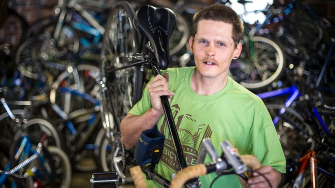 Jeff Morgan, 32, of Des Moines at the Des Moines Bike Collective on Thursday, April 23, 2015, in Des Moines.