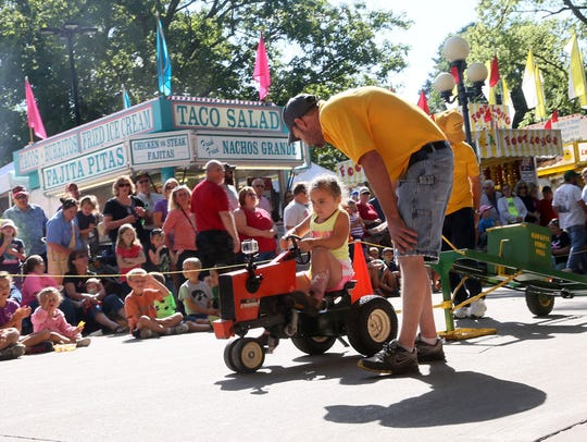 Claire Routh of Mount Ayr wins the Pedal Pull four-year-old contest in 2014