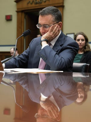 Massachusetts Institute of Technology Economics professor Jonathan Gruber prepares to testify before the House Oversight and Government Reform Committee about his work on the Affordable Care Act Tuesday. Gruber, who was a consultant paid by the authors of the Affordable Care Act and the Massachusetts universal health care program, called voters stupid and said that Obamacare would not have passed if lawmakers had really known what was inside the legislation during an academic conference earlier this year.