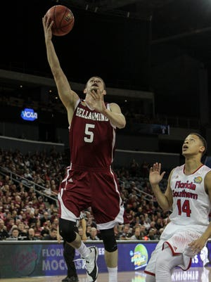 Bellarmine's Rusty Troutman (5) drives to the goal past Florida Southern's Tyler Kelly (14) during the first half of the 2015 NCAA Division II Semifinal #2 at the Ford Center in Evansville, In. March 26, 2015.