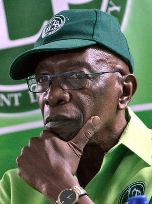 A picture taken on June 11, 2015 shows former FIFA vice-president Jack Warner listening to the speaker during a cottage meeting of his political organization, the Independent Liberal Party.