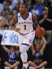 Kansas Jayhawks guard Wayne Selden Jr. (1) dribbles