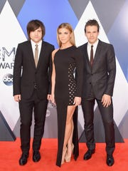 (L-R) Neil Perry, Kimberly Perry and Reid Perry of The Band Perry attend the 49th annual CMA Awards at the Bridgestone Arena on Nov. 4, 2015 in Nashville.