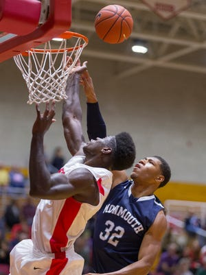 Cornell's David Onuorah, and Monmouth's Diago Quinn work to control the ball Wednesday during their game in Ithaca.