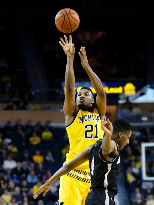 NCAA Basketball: Bryant at Michigan