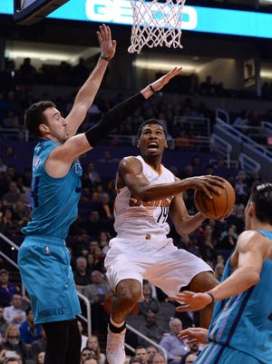 Jan. 6, 2016; Phoenix; Phoenix Suns guard Ronnie Price (14) drives the basketball against Charlotte Hornets center Frank Kaminsky III (44) in the first half at Talking Stick Resort Arena.