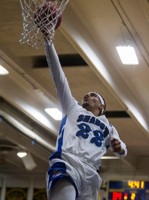 Shadow Mountain's Darion Spottsville makes a layup against La Joya Community in the second quarter during the second round of the Division II state tournament on Saturday, Feb. 20, 2016 at Shadow Mountain High School in Phoenix.