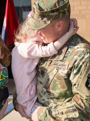 Alexandria Lyles shares a moment with her father, Capt. Matthew Lyles, at Fort Campbell.
