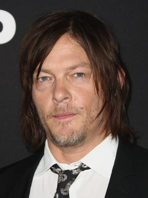 No crossbows were used in the making of Norman Reedus's cat photo.