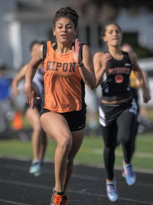 Ripon freshman Dana Caudill won the 100 meters, 200 meters and long jump at the East Central Conference meet hosted by Ripon on Tuesday.