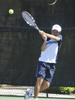 Central Valley Christian's Bailey Gong returns against Immanuel's Travis Bakker on Tuesday in a Central Section Division III championship tennis match at Demaree In-Shape Tennis Courts.
