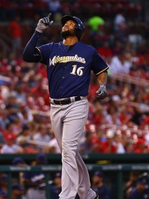 Domingo Santana crosses home plate after hitting a solo home run in the second inning on Thursday.