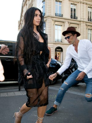 Vitalii Sediuk lunges at Kim Kardashian West on the streets of Paris.