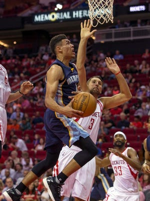 Memphis Grizzlies guard Wade Baldwin IV goes up to shoot against Houston Rockets forward Ryan Anderson in the first half of a preseason NBA basketball game Saturday in Houston.
