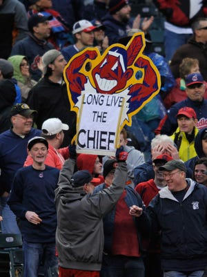A fan holds a Chief Wahoo sign during a game between the Cleveland Indians and the Minnesota Twins at Progressive Field in 2014.