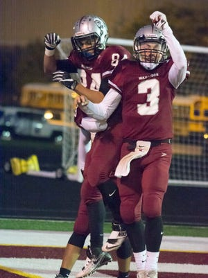 Danville's Christian Schabel (3) celebrates with Ben Stevens (84) after the pair hooked up for a score in the Warriors' win over Northwest.