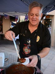 Police Chief Al Schettino teams up with Fire Chief Mike Murphy for a non-competing chili entry. The Marco Island Fire-Rescue Foundation hosted the 4th annual Jerry Adams Chili Cook Off at the Esplanade Saturday afternoon, with 600 people sampling chili from 17 different chefs and organizations.