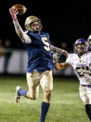Tri-West Peyton Hendershot(5) makes a one handed catch in front of Guerin Catholic Max Garsage(24) during their sectional game at Tri-West on October 21,2016.