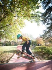 Foster Braden works out on the skateboard ramp behind