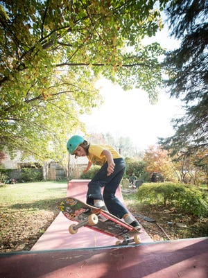 Foster Braden works out on the skateboard ramp behind his house.