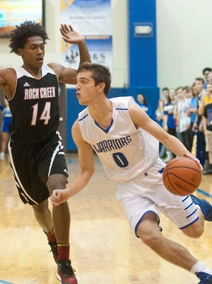 CAI guard Stephen Cook drives around Rock Creek forward-center Devin Hughes. 