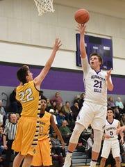 Bloomfield Hills'  Grant Ellis (21) makes a jump shot