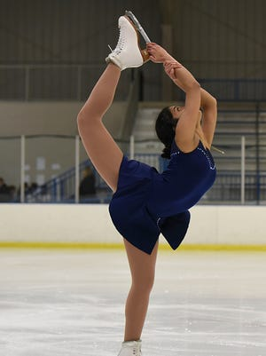 Rhea Dhar is a sophomore member of the combined CDMCK figure-skating team which competed Thursday at the Detroit Skating Club.