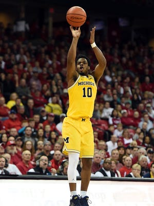 Michigan's Derrick Walton Jr. takes a three-point shot during the second half of U-M's 68-64 loss to Wisconsin on Tuesday, Jan. 17, 2017 in Madison, Wis.