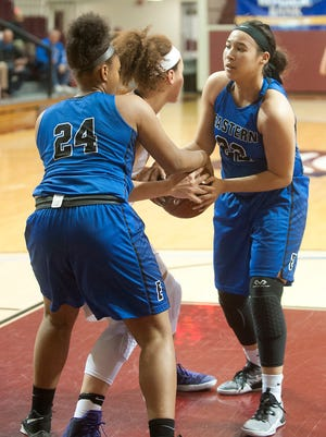 Eastern center Destiny Houseal, left, and Eastern guard-forward Natalie Collins tie up Male center Cameron Browning in the second round of the Girls LIT.25 January 2017