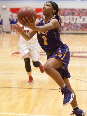 Male guard Ciaja Harbison drives to the basket in the Girls' LIT championship.
