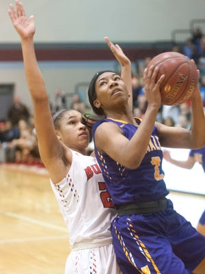 Male guard Ciaja Harbison puts up a shot in front of Butler forward Jaelynn Penn in the Girls' LIT championship.