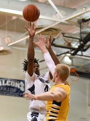 Farmington's Ray Bryant (4) registered a double-double (19 points, 11 rebounds) in Tuesday's win over Country Day.