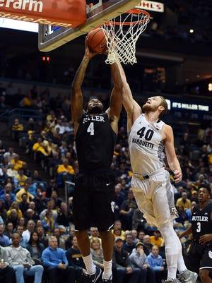Butler's Tyler Wideman drives to the basket against Luke Fischer.