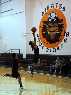 Paint Creek's Manuel Acosta (33) leaps up to catch a long inbound pass during the Pirates' practice on Thursday in Paint Creek.