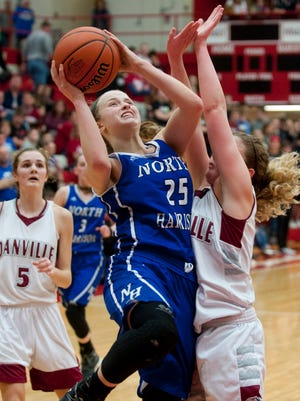North Harrison guard Cali Nolot collides with Danville (In.) guard Lexi Riggles as Nolot drives to the basket.18 February 2017