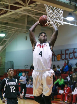 Provine's Johnny Bingham prepares for a dunk in the first quarter. Provine and Pascagoula played in an MHSAA Class 5A boys playoff basketball game on Tuesday.