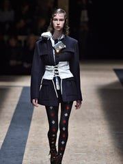 A model shows off a corseted belt at the Prada Autumn