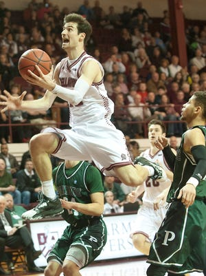 Bellarmine University forward Adam Eberhard leaps into the air to score in the NCAA Division II Midwest regional opener in Knights Hall.11 March 2017