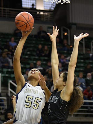 Detroit Country Day's Tylar Bennett (55) , shown hitting a layup over Arbor Prep's Lasha Petree (4), proved a pivotal presence in the paint at the Breslin Center.